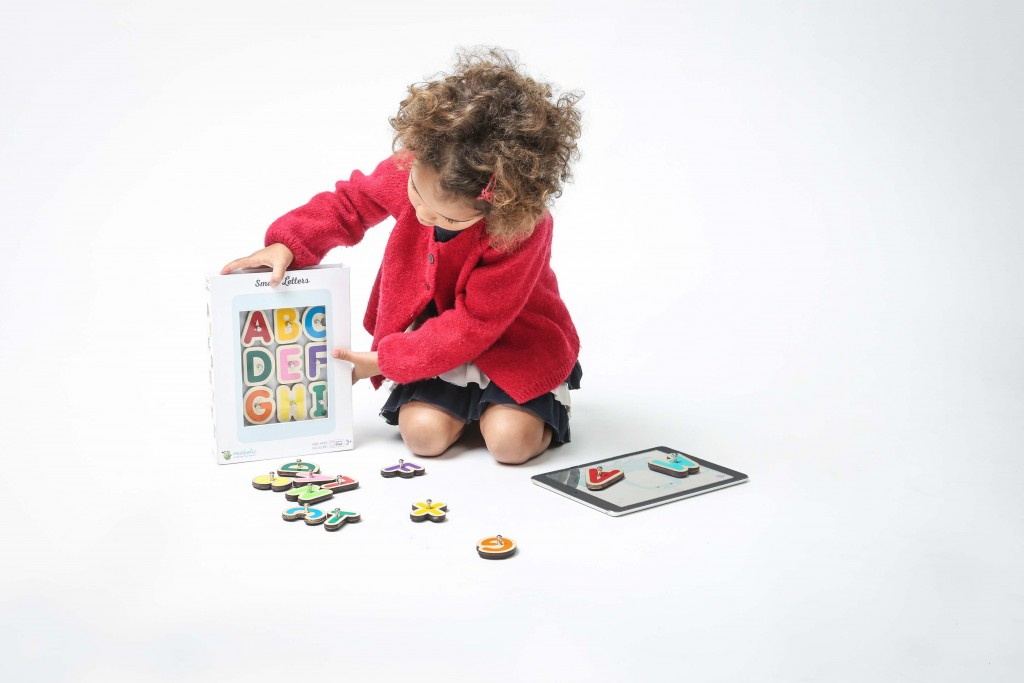 Girl playing smart letters 1024x683